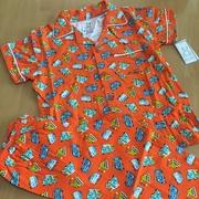 ชุดนอนเด็กผ้ายืดลายรถตักดินสีส้ม > 2 ขวบ