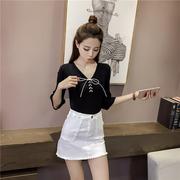 เสื้อแฟชั่นเกาหลี แต่งคอสายถักผูกโบว์ สีดำ