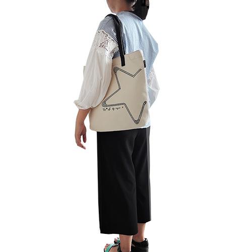 agnes b star studded cowboy tannins handbag (meters)